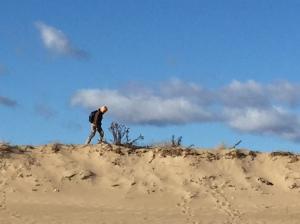 Julianna following a grey fox